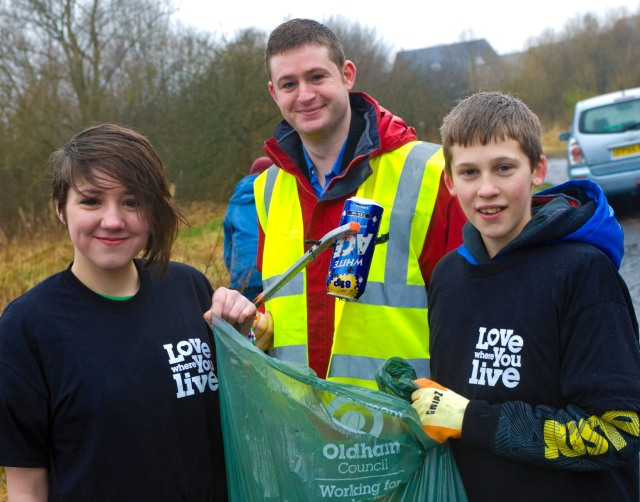 LOVE WHERE YOU LIVE: Jim McMahon with local volunteers cleaning up at Moston Brook