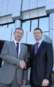 EXPANSION: Paul Naylon, NOV Mono's Managing Director, shakes on the Greengate deal with Jim McMahon, Council Leader