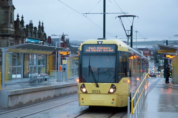 ALL ABOARD: One of the first trams to take the journey on Oldham's new town centre Metrolink line on Monday
