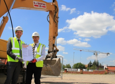 KICK-OFF: Signing the the Get Oldham Working Construction Charter and breaking the ground at the new Oldham Sports Centre with Anthony Dillon, Willmott Dixon's Northern Managing Director.