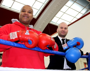 VOLUNTEERING: Caption: Council employee Mark Prestwich with Eric Noi, Principal at Oldham Boxing and Personal Development Centre, helped secure funding worth thousands of pounds which has helped pay for a new roof at the Greaves Street gym.