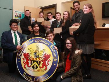 NOISY NEIGHBOURS? Oldham Youth Council members moving into their new base at the Civic Centre.